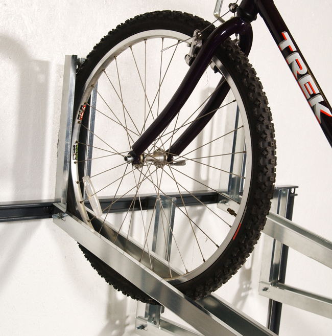 Bikes are easy to store - just place a bike onto the tray and roll forward.